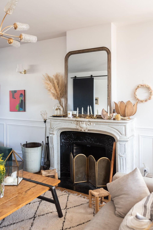 Parisian fireplace neutral decor and Pampas grass via TheSocialiteFamily Mylene Kiener