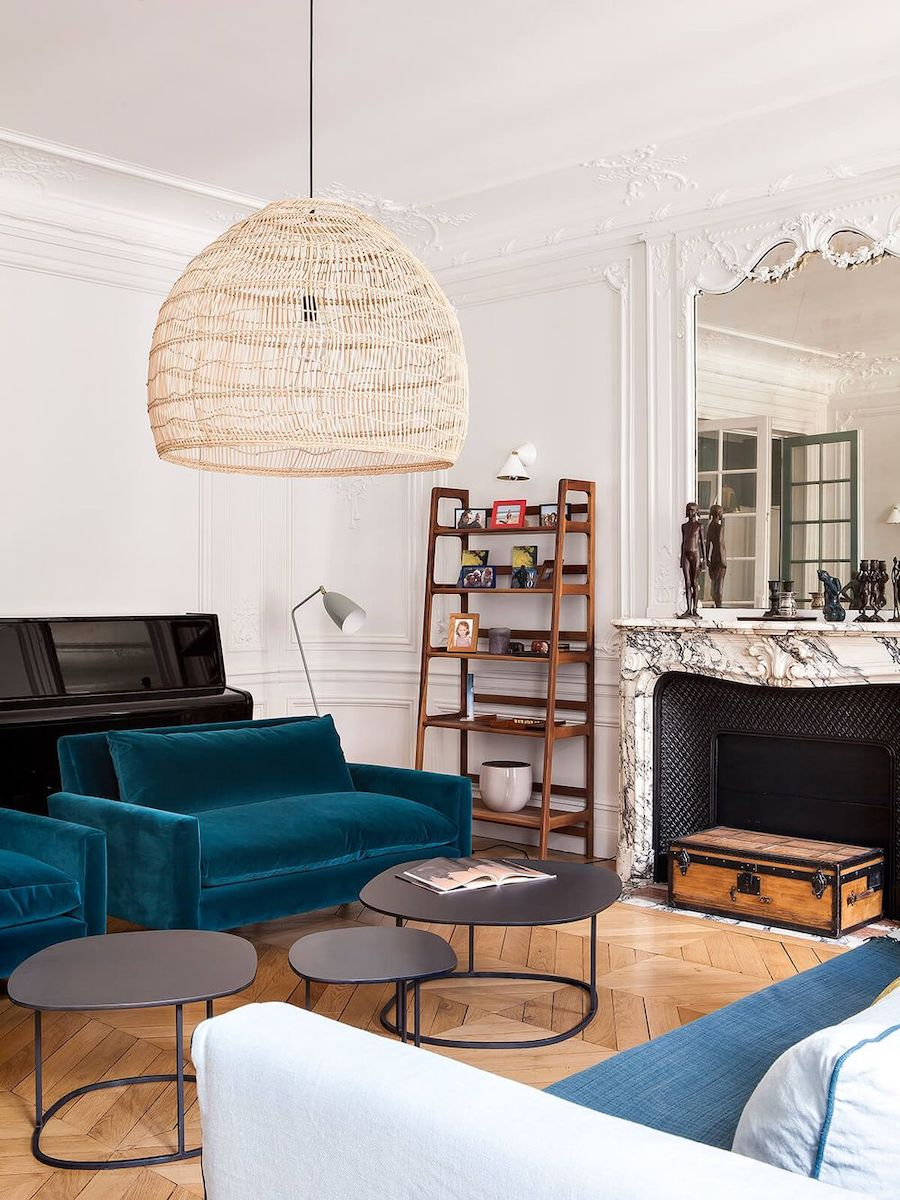 Parisian fireplace with Vintage trunk in living room via Camille Hermand