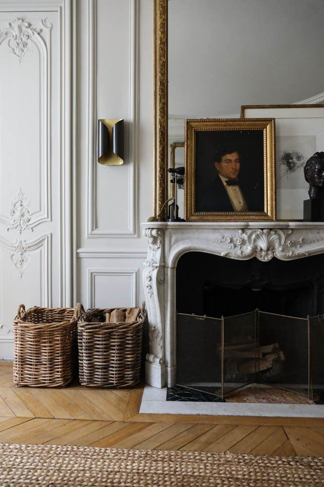 Parisian fireplace with dark Vintage painting via TheSocialiteFamily Dorothee Boissier