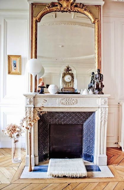 Parisian fireplace with Vintage objects