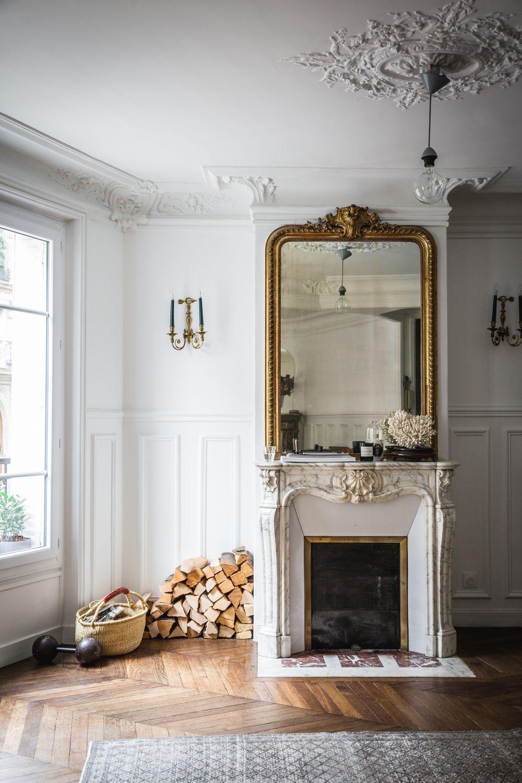 White marble Parisian Fireplace with gold mirror via AptLafayetteParis