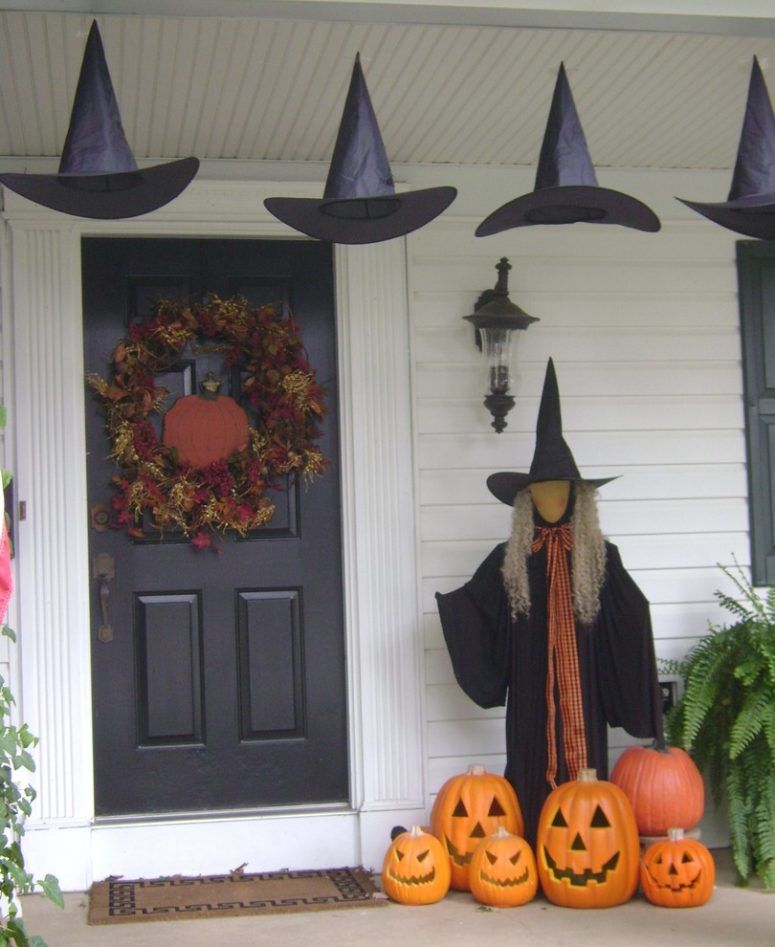 Witch at the front door Halloween porch decor idea