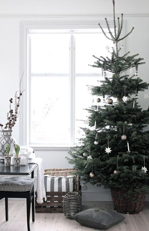Christmas tree next to black Scandinavian Dining Table