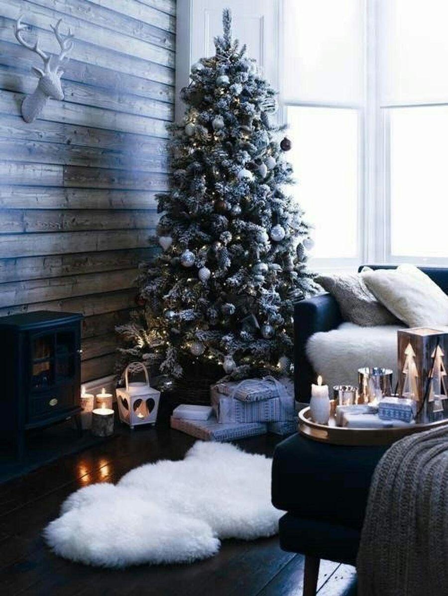 Dark wood rustic Scandi Christmas Family Room Decor with faux fur rug