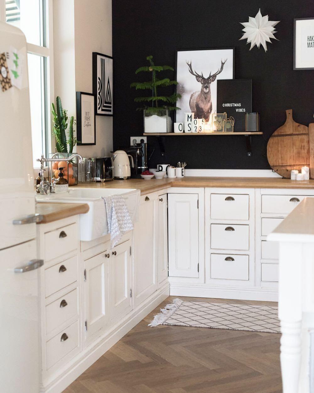 Reindeer Art in Scandi Black Kitchen