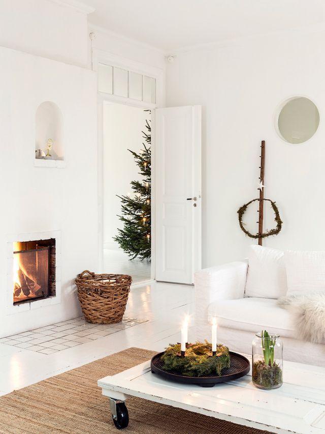 Scandi Christmas Living Room Decor with Jute Rug and White Sofa via Carina olander
