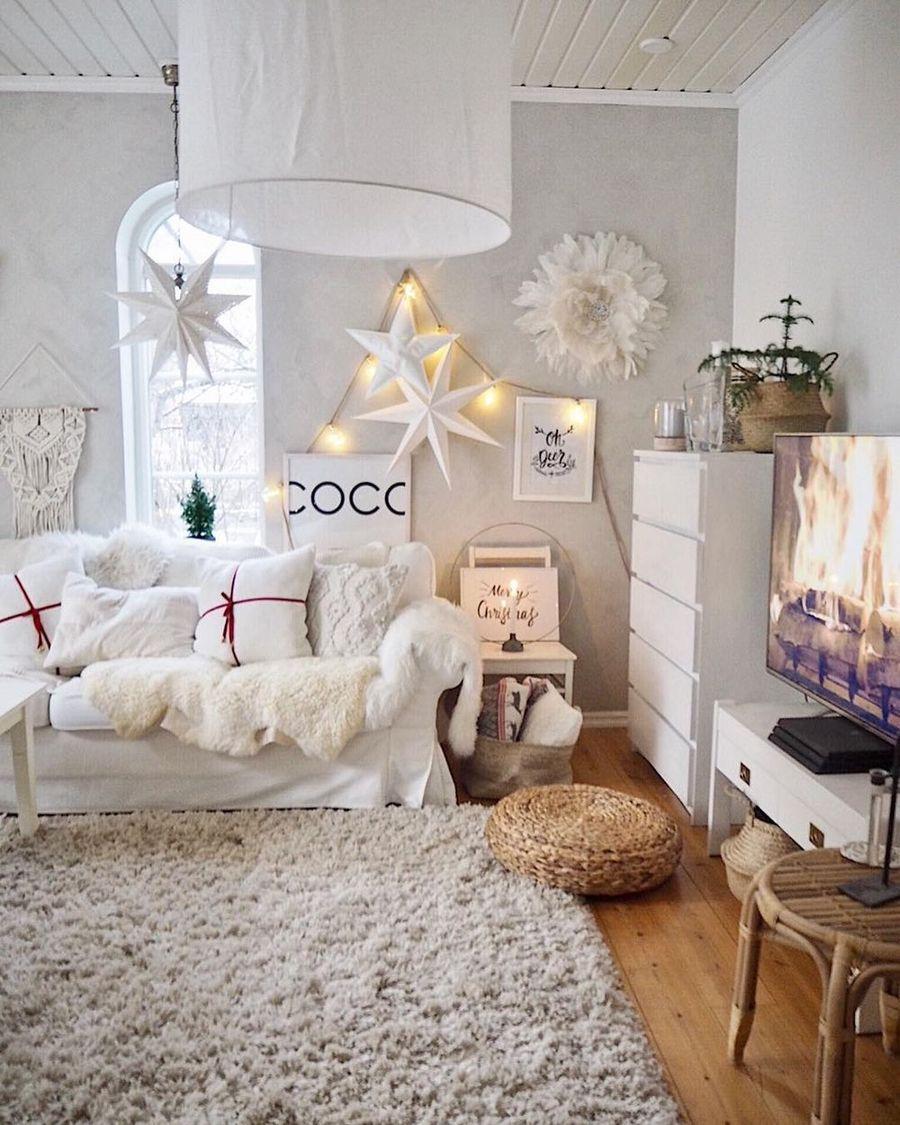 Scandi Christmas Living Room Decor with white stars and sofa via @prinsessavanessa