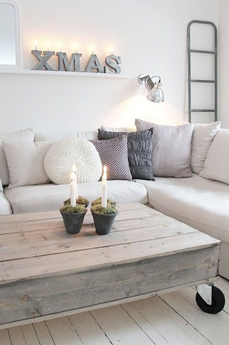 Scandi Christmas Living Room with XMAS wall sign and candles on coffee table