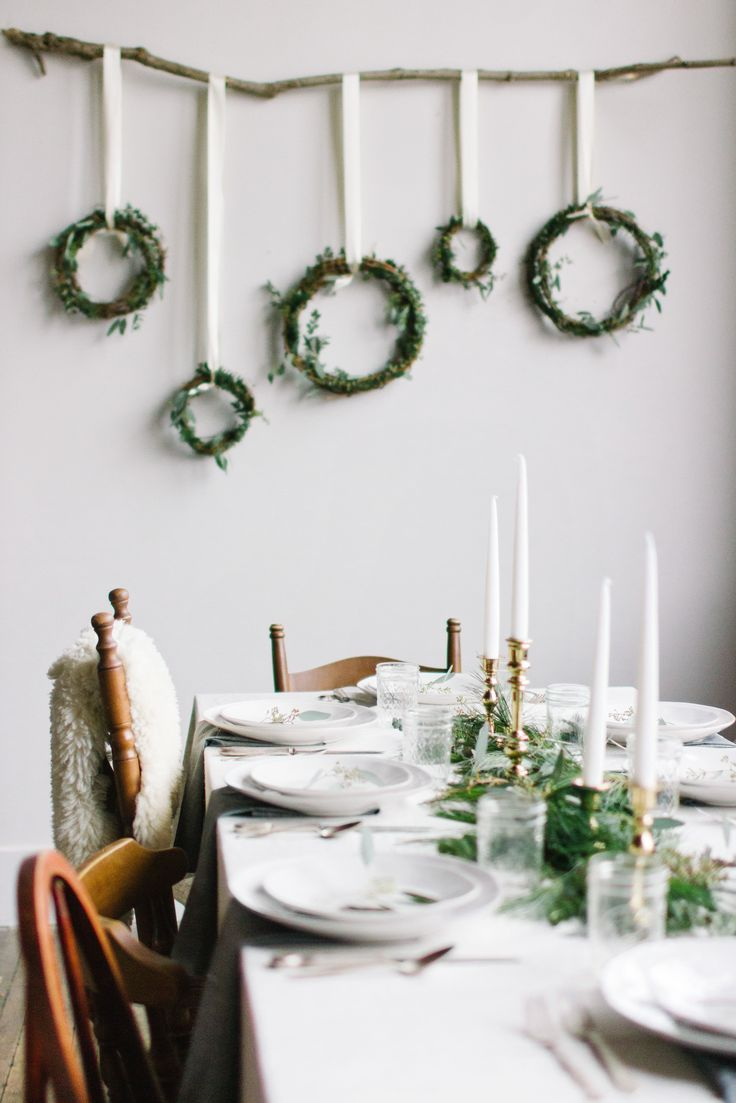 Scandi Christmas dining room decorating with hanging wreath wall decoration