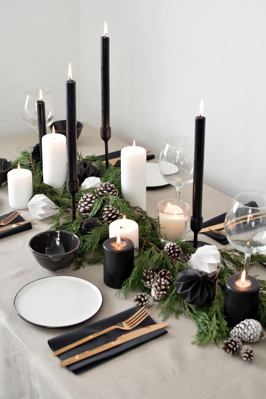 Scandinavian Christmas table setting decor with Black Candles and Pinecones via burkatron