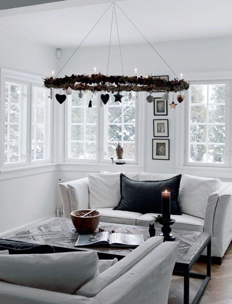 Wintry Scandi Living room with wreath chandelier via Femina