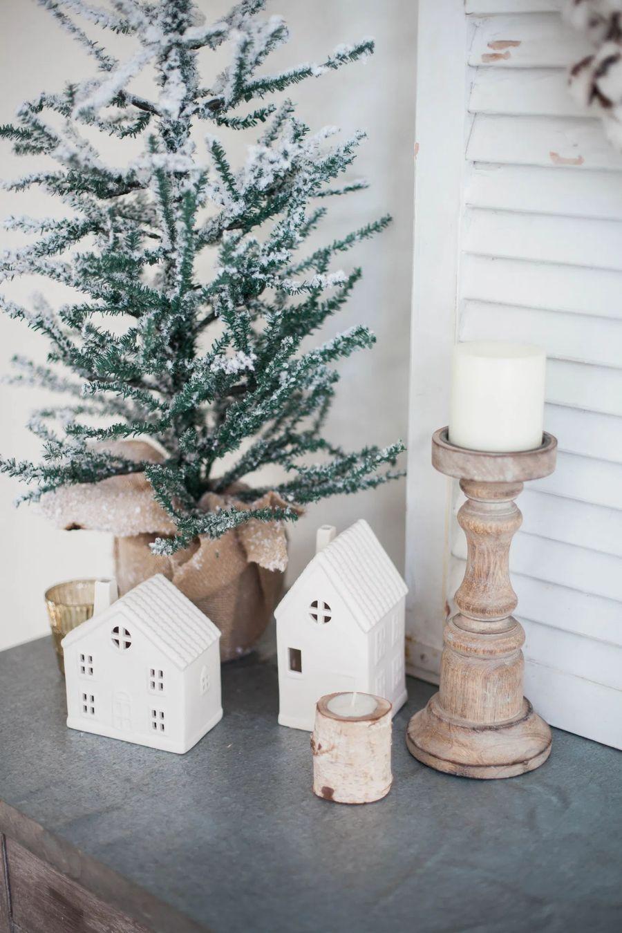 Evergreen tree and winter white houses via laurenmcbrideblog