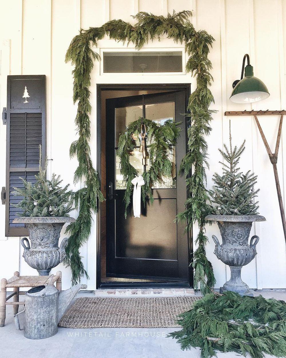 Farmhouse evergreen winter entryway decor via @whitetailfarmhouse