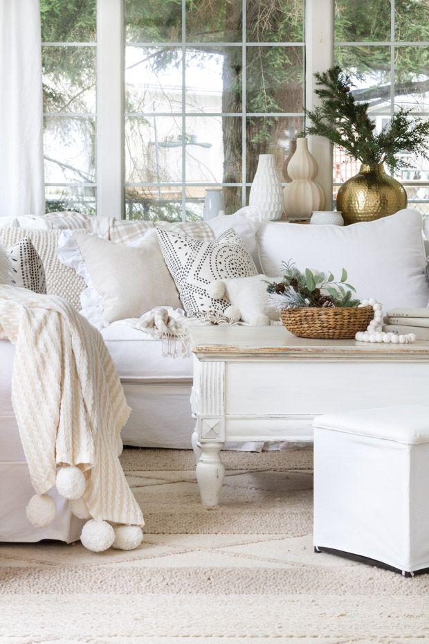 Neutral throw pillows on the sofa via zevyjoy