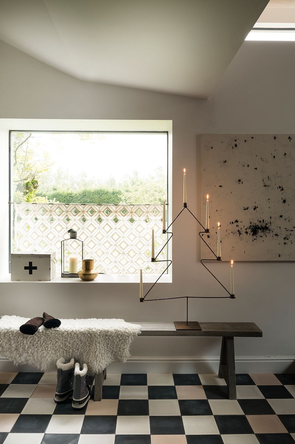 Scandi Christmas Entryway Idea with wire Christmas candle tree and fur throw