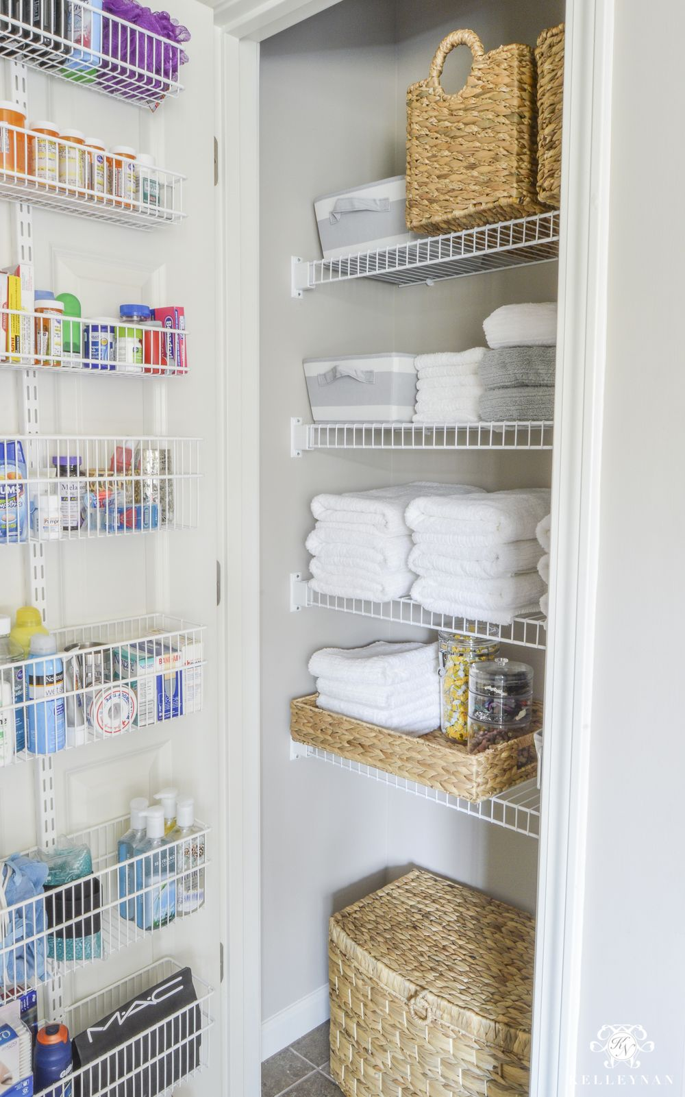 Bathroom Linen Closet Organization with White Shelves and Wicker Baskets via kelleynan