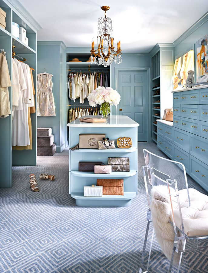 Blue Walk-in closet with Clothing and Handbags with Chandelier via Traditional Home