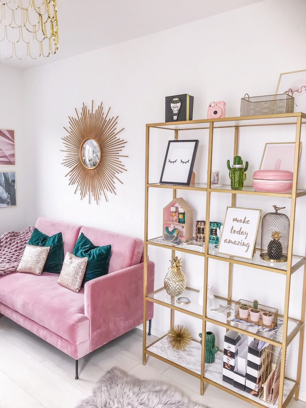 Glam pink sofa and gold bookcase via fashionhippieloves