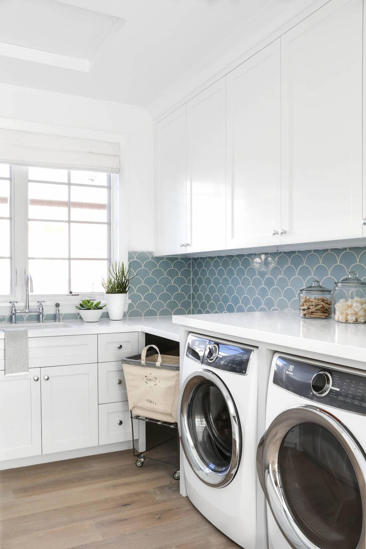 Laundry Room with Blue Tile Backsplash via Lindye Galloway Interiors